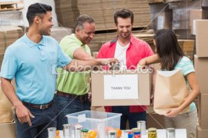 depositphotos_69017063-warehouse-workers-packing-up-donation
